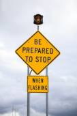Be prepared to stop when flashing, road sign — Stock Photo