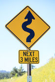 Winding road next 3 miles, road sign — Stock Photo