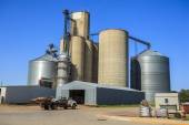 Silver, shiny agricultural silos — Stock Photo