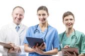 Three competent doctors ready to help — Stock Photo