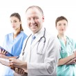 Three competent doctors ready to help — Stock Photo #67608389