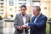 Two business people discussing outside the office — Stock Photo
