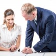 Businessman and businesswoman signing a papers — Stock Photo #72626515