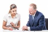 Businessman and businesswoman signing a papers — Stock Photo