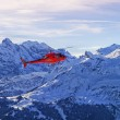 Red helicopter at swiss alps near Jungfrau mountain — Stockfoto #56275203