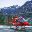 Red helicopter on the base in swiss alps — Стоковое фото #56275209