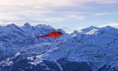 Red helicopter at swiss alps near Jungfrau mountain  — Stock Photo