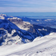 Helicopter view to the winter sport resort in swiss alps — Stockfoto #56505309