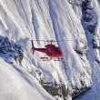 Red helicopter in swiss alps Jungfrau region — Stockfoto #56505503