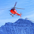 Red helicopter at swiss alps near Jungfrau mountain — Foto de Stock   #56505575