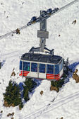 Cable car railway cabin on winter sport resort in swiss alps — Stock Photo