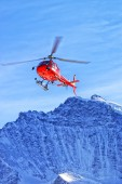 Red helicopter at swiss alps near Jungfrau mountain — Photo