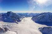 Swiss Aletch glacier crossing flows helicopter view in winter — Stock Photo