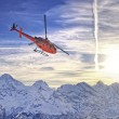 Red helicopter at swiss alps near Jungfrau mountain — Stockfoto #56672367