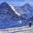 Two girls on ski at winter sport resort in swiss alps — Stok fotoğraf #56763903