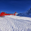 Red helicopter at swiss alps ski resort near Jungfrau mountain — Stockfoto #57768999