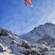 Red helicopter at swiss alps sky near Jungfrau mountain — Стоковое фото #58024319