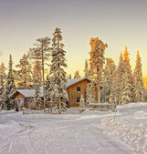 Wooden cottage house at winter Lapland — Stock Photo