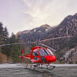 Red helicopter in heliport at swiss alps 2 — Стоковое фото #58804097