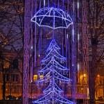 Christmas tree art style in night european city street — Stock Photo #58903809