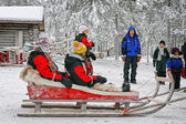 Couple in the reindeer sledges — Foto de Stock