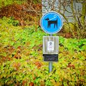 Sign for dog fouling cleaning and special bags — Stock Photo