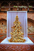 Christmas tree made of fire wood — Stockfoto