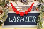 Cashier plate with christmas decorations and red balls — Stock Photo