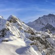 Four alpine peaks and skiing resort in swiss alps — Zdjęcie stockowe #62828391
