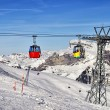 Cable car cabins on the swiss ski resort slope — Stock Photo #62912373