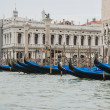 Row of gondolas near Doges palace in summer Venice — Stock Photo #67197683