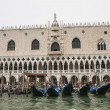 Gondolas pier near Doges palace in summer Venice — Stock Photo #67280225