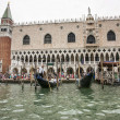 Gondolas and gondolier with tourists  near Doges palace in summe — Stock Photo #67487267