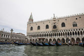 Gondolas parking near Doges palace in summer Venice — Stock Photo