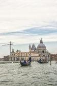 Venice, Italy - August 26, 2012: Santa Maria della Salute basilica and gondoliers in summer Venic — Stock Photo