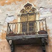 Italian classic neglected balcony — Stock Photo