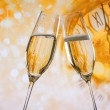 New Year or Christmas at midnight with champagne flutes make cheers, golden bokeh and clock — Stock Photo #52391961