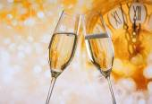 New Year or Christmas at midnight with champagne flutes make cheers, golden bokeh and clock — Stock Photo