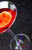 Top of view of red cocktail on wood table with space for text  — Stock Photo