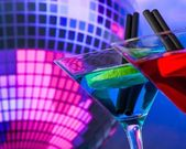 Blue cocktail with sparkling disco ball background with space for text selected focus — Stock Photo
