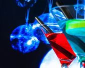 Cocktail with blue sparkling disco ball background with space for text — Stock Photo