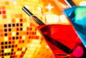 Detail of cocktail with sparkling disco ball background with space for text — Stock Photo