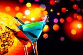 Blue and red cocktail with sparkling disco ball background with space for text — Stock Photo