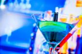 Blue and red cocktail with lounge bar background with space for text — Stock Photo