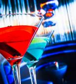 Blue and red cocktail in lounge bar background — Stock Photo