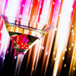 Red dice in the cocktail glass on colorful gradient — Stock Photo #55197113