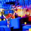 Red dice in the cocktail glass in front of lounge bar casino — Stock Photo #55297613
