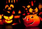 Halloween night background with scary pumpkins in background — Stockfoto