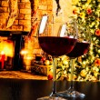 Two red wine glasses against christmas tree background — Stock Photo #58021559