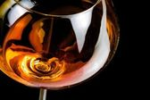 Snifter of brandy in elegant glass with space for text — Stock Photo